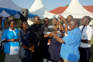 Guest of Honour,Fr. Fred handing over the trophy to the best school in prose